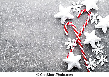 Candy cane. Christmas decors with gray background. -...