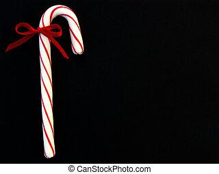 candy cane on black background