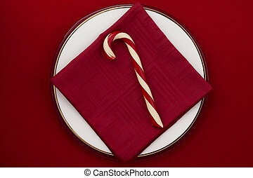 candy cane on red background
