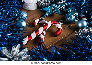 Candy cane on the background of Christmas decorations