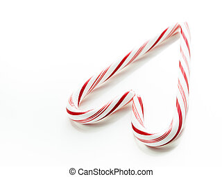 Candy cane - White and red peppermint candy canes forming...