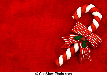 Candy Cane - A candy cane with a bow on a red textured...