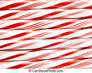 Candy cane - White and red peppermint candy canes in a row...