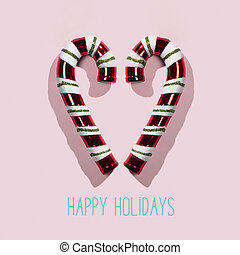 candy canes and text happy holidays