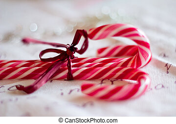 candy canes as Christmas ornaments with shallow depth of field
