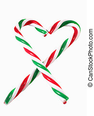 Candy Canes - Candy cane ornaments form a heart; white...