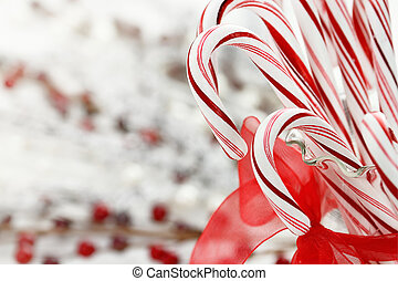 Candy canes in a glass dish with copy space.