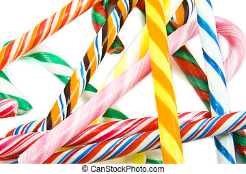 Candy-canes - Colorful candy-canes on a pile on a white ...