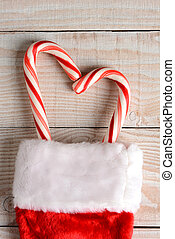Candy Canes in Christmas Stocking - High angle image of a...
