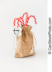 Candy Canes in Jute Sack isolated on White