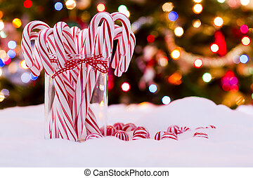 Peppermint candy canes on white background.