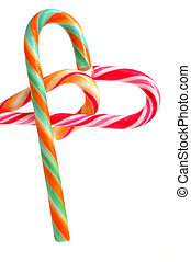 candy canes - some candy canes forming a heart on a white...