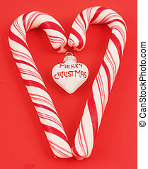 candy canes - Colorful candy canes as a heart with a white...