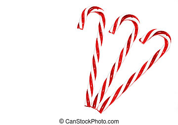 Three candy canes on white