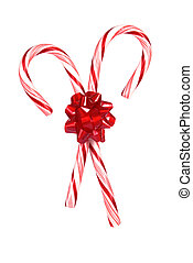 Candy canes with a red bow isolated on white