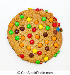 Freshly baked sugar cookie topped with colorful milk chocolate candies