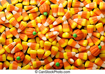 Candy corn and pumpkin Halloween background