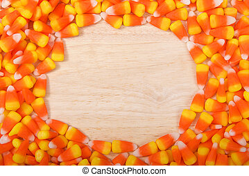 Candy corn border on wood table
