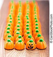 Candy Corn Pumpkins In A Row With Jack-o'-lantern Face