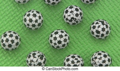 Candy footballs on a green background