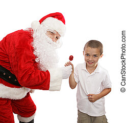 Candy From Santa - Santa and an adorable little boy posing...