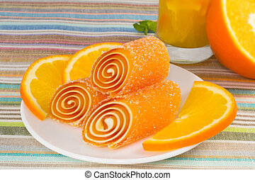 candy fruit on a plate with orange