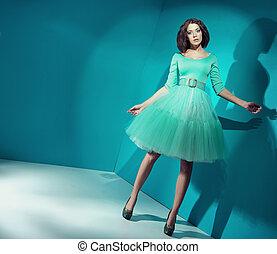 Candy girl wearing bright green dress