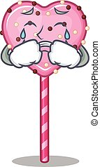 Candy heart lollipop cartoon character concept with a sad face