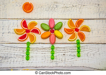 candy is laid out on the background, in the form of flowers