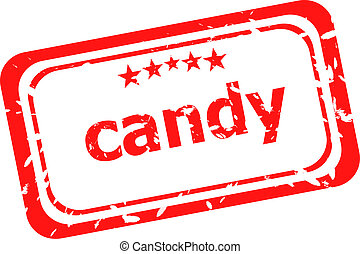 candy on red rubber stamp over a white background