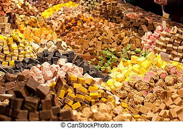 Candy. - Candy on store shelves, in a large range.