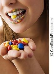candy smarties between teeth