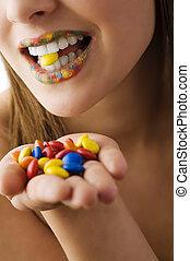candy smarties between teeth