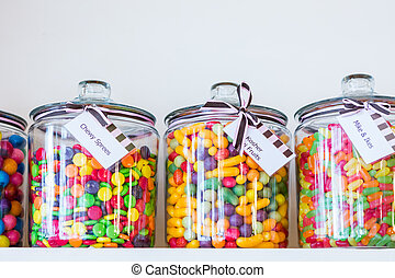 Candy store - Jars filled with different candies at the...