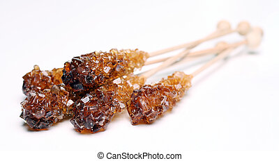 Candy sugar on a stick over white background