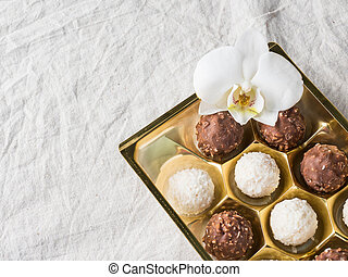 Candy with Coconut in a Gold Box of the Cell on the Table of the Coffee beans Copy space
