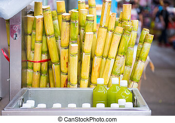 cane and fresh sugarcane juice in bottle