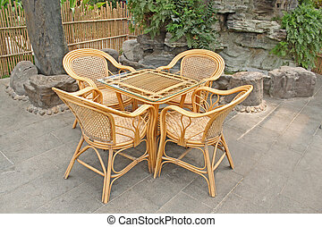cane chair and glass table