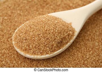 Cane sugar - Brown sugar in a wooden spoon