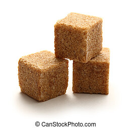 Cane sugar cubes on white background