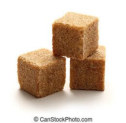 Cane sugar cubes on white background