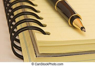 caneta, caderno, amarela