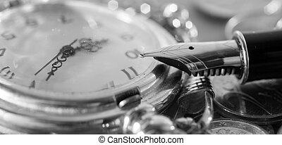 caneta, relógio bolso
