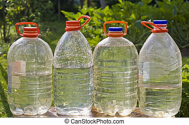 Canisters, bottles with pure water