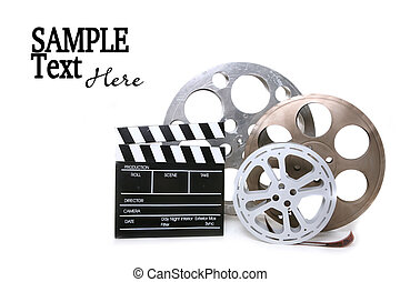 Canisters of Film With Directors Clapboard on White Background