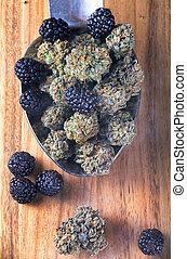 Cannabis buds (Berry Noir strain) with fresh fruit - medical...