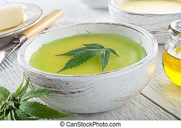 Delicious homemade cannabis butter with marijuana leaf garnish.