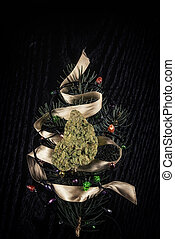 Cannabis dry bud over pine tree branch resembling a...