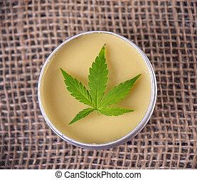 Cannabis hemp cream with marijuana leaf - cannabis topicals concept