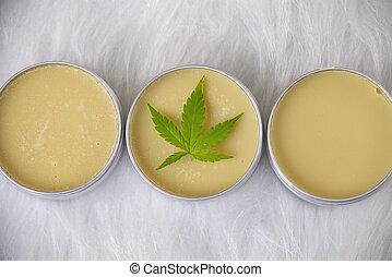 Cannabis hemp creams with marijuana leaf over white